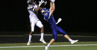 Western's Jack Weyher picks off a pass. Photo by Ashley Thornton